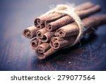 Cinnamon Sticks Over Black...