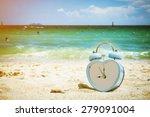 Old Retro Clock On Sand Beach ...