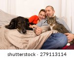 Stock photo a couple lying with her dog and her cat on the sofa 279113114