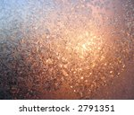 iceflowers (frost) on window, behind glass - sunrise on cold winter day - stock photo