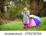 happy little girl with umbrella ...   Shutterstock . vector #279270704