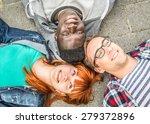 three mixed race friends lying... | Shutterstock . vector #279372896