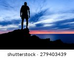 man hiking silhouette...