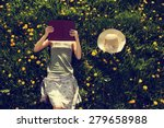 Girl Lying In Grass  Reading A...
