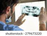 Closeup Of Dentist Looking At...
