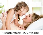 happy middle aged mom playing... | Shutterstock . vector #279746180