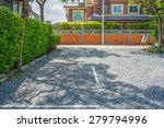 Gravel Yard With Tree And House