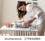 mother changing her baby... | Shutterstock . vector #279846884
