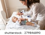 mother changing her baby... | Shutterstock . vector #279846890