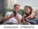 young laughing couple hanging...   Shutterstock . vector #279865676