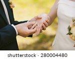 wedding rings and hands of... | Shutterstock . vector #280004480