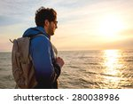 young man wearing a backpack... | Shutterstock . vector #280038986