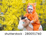 infant baby girl on horse | Shutterstock . vector #280051760