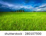 Meadow and stormy sky - stock photo