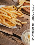 french fries on wooden table.... | Shutterstock . vector #280224110