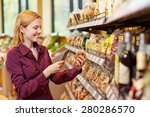 young woman scanning barcode of ... | Shutterstock . vector #280286570