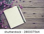 Blank Notebook With Flower On...