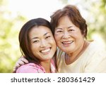asian mother and adult daughter ... | Shutterstock . vector #280361429