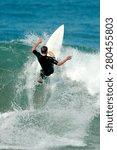 A Surfer Carves A Radical...