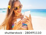 Female Tourist Using Portable...