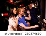 Young People At Slot Machine I...