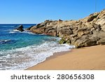 Beach And Rocks In Platja D'ar...