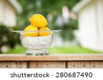 Lemons in a glass bowl at a lemonade stand - stock photo