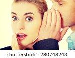 Men Whispering Secret To His...
