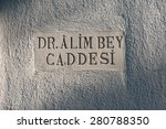 Small photo of A street sign in Bodrum, Turkey dedicated to Dr Alim Bey.