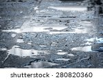 Rain Puddles On A Pavement In...