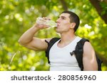 Active Man Drinking Water From...