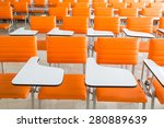 classroom with many orange...