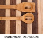 Slotted Wood Spoons On Rustic...