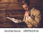 stylish man with newspaper in... | Shutterstock . vector #280962416