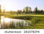 Golfer At Sunrise