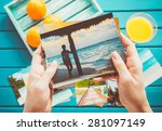 woman looking at photos in her... | Shutterstock . vector #281097149
