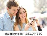 happy couple with earphones... | Shutterstock . vector #281144330