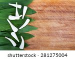 Small photo of wild garlic Allium tricoccum on wood background
