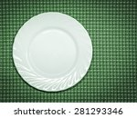 empty plate on green tablecloth  | Shutterstock . vector #281293346