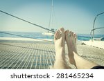 man lounging on a catamaran... | Shutterstock . vector #281465234