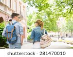 Stock photo rear view of young college friends talking while walking in campus 281470010