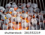 Burning Grill Briquettes With...