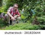 man loosen the soil in his... | Shutterstock . vector #281820644