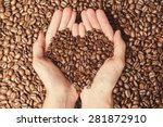 coffee beans in the hands of... | Shutterstock . vector #281872910