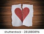 Broken Paper Heart On A Wooden...