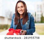 woman holding a gift | Shutterstock . vector #281955758
