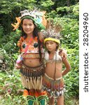 Small photo of BOCA DE VALERIA: MARCH 11: Two young Indian girls are encountered in the rain forest on the Amazon River on March 11, 2009, in Brazil