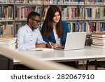 in the library   handsome two... | Shutterstock . vector #282067910