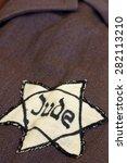 yellow star of david on his coat   Shutterstock . vector #282113210