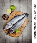 raw seabass fish on the wooden... | Shutterstock . vector #282124730
